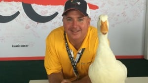 Not Mock Duck: Jon Sullivan and a live Aflac duck. Mechanized ducks soon will comfort children with cancer.