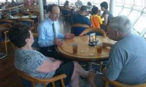 President and CEO, Adam Goldstein, (second from the left) meeting with guests onboard Grandeur of The Seas