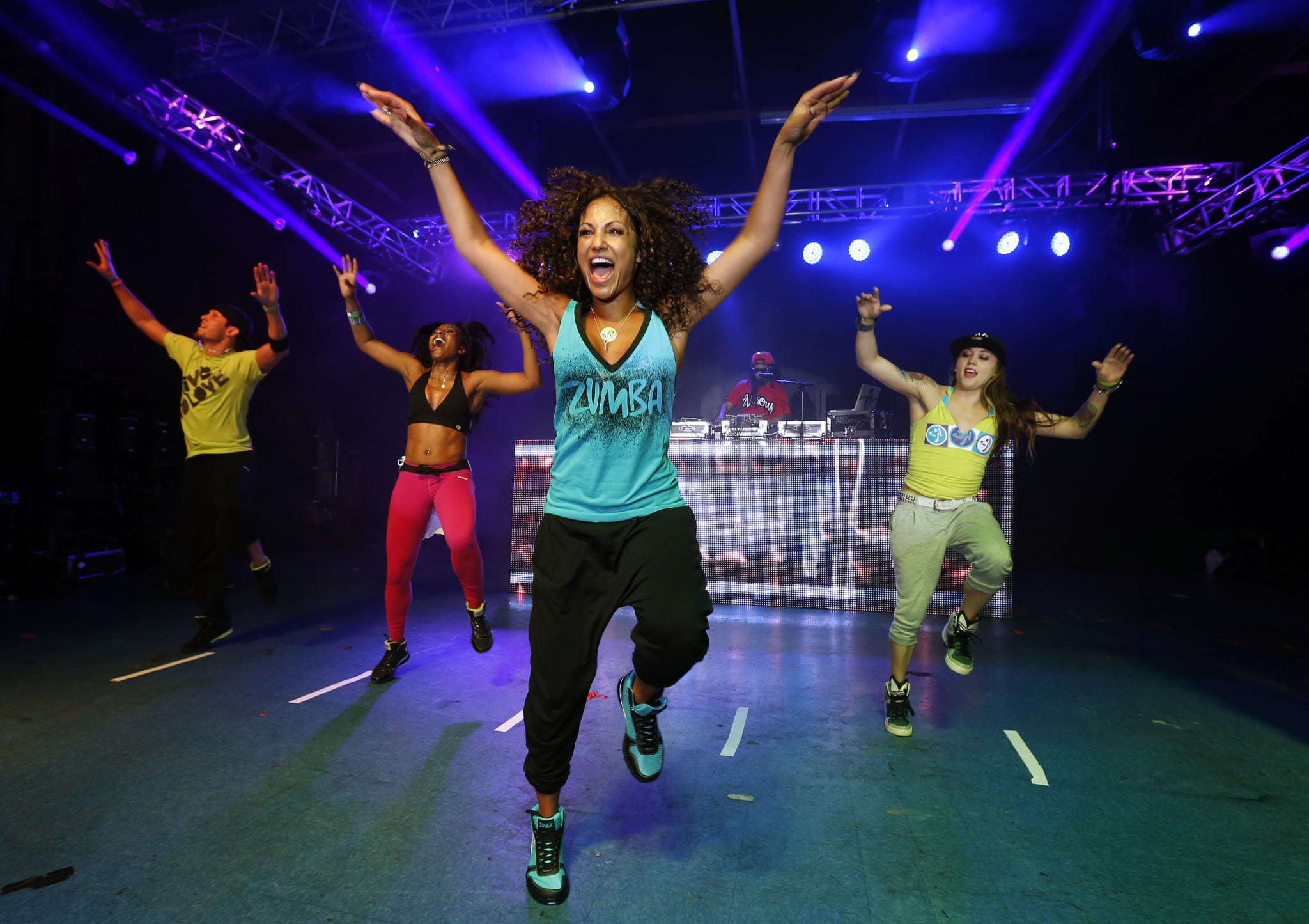 Celebrity Zumba Instructor Gina Grant, alongside Lil Jon on the turntables, leads a Zumba class at Amazura nightclub in Queens, N.Y. (one of the many stops in the Zumba Nightclub Series).
