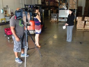 Sari Vatske, VP of community relations at Feeding South Florida, speaks with a television reporter regarding the government shutdown and how the nonprofit responded.