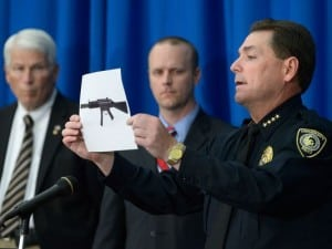 University of Central Florida Police Chief Richard Beary (right) holds a photo of the type of weapon a student planned to use in a campus attack. UCF President John C. Hitt (left) and UCF Spokesperson Grant Heston (center ) look on.