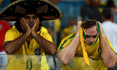 Brazil fans react to Tuesday's historic loss. Image: bbc.co.uk