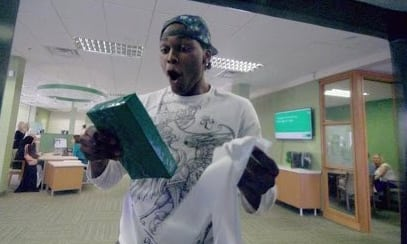 A surprised TD Bank patron gets a personalized gift from a special ATM.