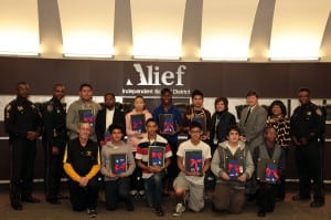 """Students from the Alief School District receive their Kindle Fire tablets from CITGO and the Harris County Sheriff's Office, part of the """"Kindling Young Minds"""" campaign."""