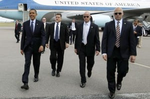 QUESTIONABLE SERVICE: The Secret Service, seen here with President Obama, is under scrutiny following a series of embarrassing scandals. On September 19th a man scaled a fence, then ran past guards into the White House, where he was eventually apprehended. The incident led to the resignation of Secret Service director Julia Pierson.
