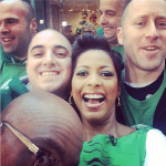 Tamron Hall, anchor on the Today Show, with St. Baldrick's volunteers and Al Roker's head.