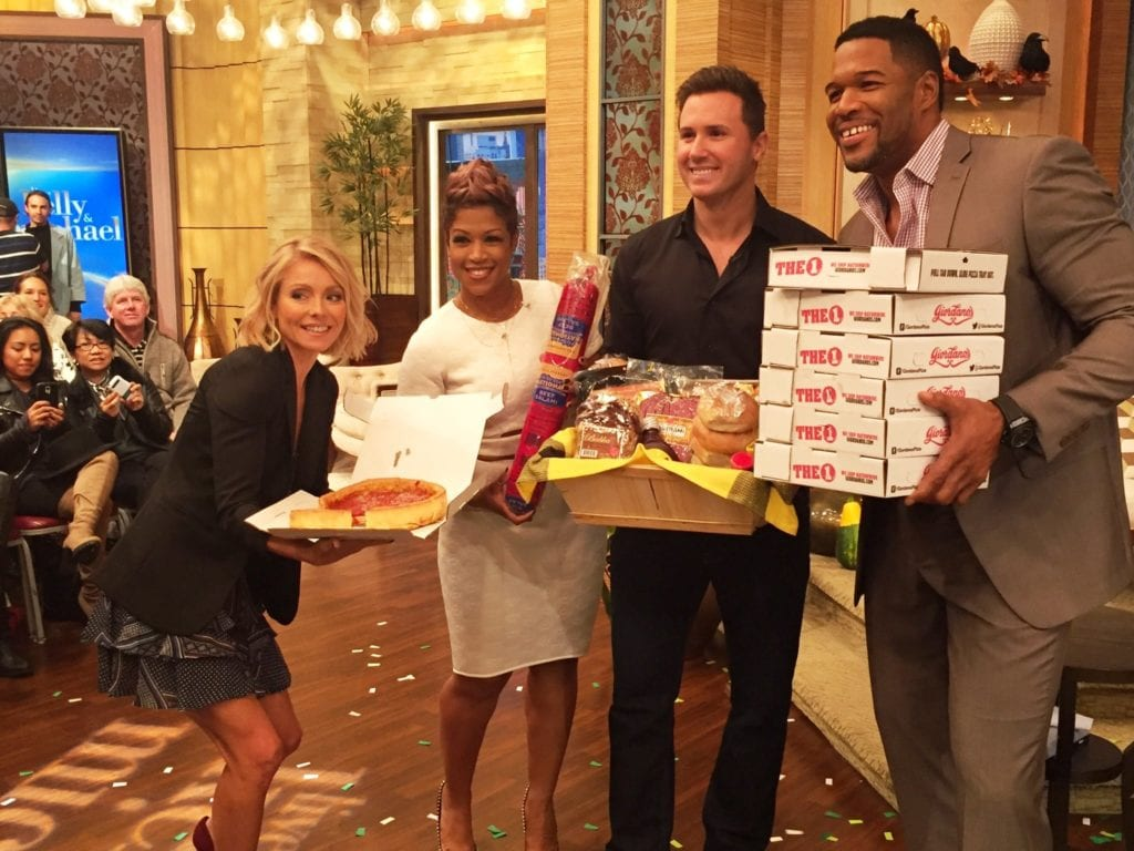 "PIE HIGH: We're sure Michael Strahan (right) easily can down those 6 deep-dish pies from Giordano's, but it might take Kelly Ripa (left) all day to eat just one. ""Windy City Live"" hosts Val Warner (next to Kelly) and Ryan Chiaverini delivered the pizzas."
