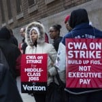 Verizon workers picket in front of a company facility, Wednesday, April 13, 2016, in New York. Tens of thousands of Verizon landline and cable workers on the East Coast walked off the job Wednesday morning after little progress in negotiations since their contract expired nearly eight months ago. (AP Photo/Mark Lennihan)