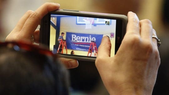 A woman records on a smart phone during a town hall meeting for Democratic presidential candidate, Sen. Bernie Sanders, I-Vt., at Nashua Community College in Nashua, N.H., Saturday, June 27, 2015. (AP Photo/Michael Dwyer)