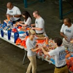 Food Lion associates taking part in the Food Lions Feeds program at the Second Harvest Food Bank in Charlotte, NC.  Charlotte Photographer - PatrickSchneiderPhoto.com