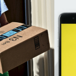 Amazon delivery box, next to Snapchat loading screen on smartphone
