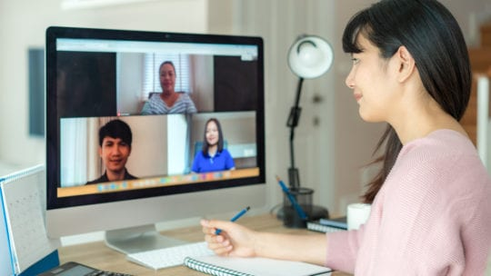 Asian woman video conferencing