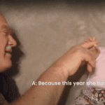 Grandpa plays with baby granddaughter